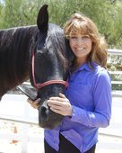 Sharon, founder of Mane-ly Long Hair standing with her horse, Sedona